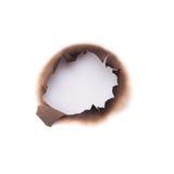 Agujero quemado imagen de archivo