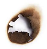 Agujero quemado del papel Foto de archivo