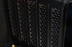 agujeros de ventilación negros polvorientos de la caja del ordenador foto de archivo libre de regalías