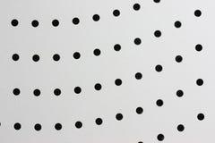 Agujeros redondos en una superficie de metal Imagen de archivo