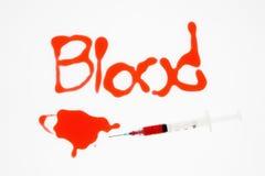 Agulha com sangue. Fotos de Stock