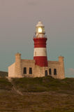 Agulhas lighthouse. Lighthouses are build to warn mariners of dangerous coastlines, and assist them with navigation Royalty Free Stock Photos