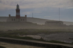Agulhas Lighthouse. Cape Agulhas lighthouse at the most southern point of Africa Stock Photography