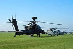 AH-64d and Westland Lynx on the flight lane. DUXFORD, UK - OCTOBER 10: AH-64d and Westland Lynx helicopters are demonstrated on the flight lane during Autumn Air Stock Photos