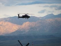 AH-64 Apache in northern Afghanistan. AH-64 Apache flying over the Hindu Kush mountains in Afghanistan Royalty Free Stock Photos