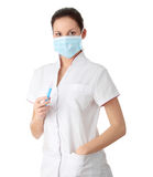 AH1n1 concept. Young nurse in mask with syringe, isolated on white background Royalty Free Stock Photo