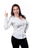 Aha! I've got an idea!. Woman pointing up, smiling and saying Yeah! on white background Royalty Free Stock Images