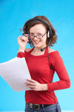 Ahaa!!. Young businesswoman in red dress on blue background Royalty Free Stock Image