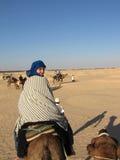 Ahead. The tourist on a camel, Sahara,Tunisia Stock Images
