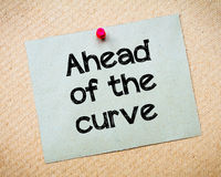 Ahead of the curve. Message. Recycled paper note pinned on cork board. Concept Image royalty free stock photos