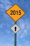 2015 ahead roadsign. 2015 ahead road sign over blue sky with clouds royalty free illustration