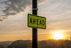 Ahead street sign. `Ahead` Street sign with sunrise background. Inspirational image. Motivational image. Sunrise Sunset cloud background. Beautiful Sky royalty free stock photo