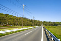 Ahead uphill straight roadway Royalty Free Stock Images