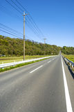 Ahead uphill straight roadway Stock Photography