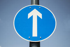 Ahead only 1 way. Blue 1 way sign arrow showing ahead only Stock Photo