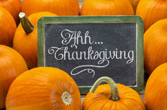 Ahh ... Thanksgiving - sign on blackboard with pumpkin Stock Photos