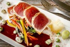 Ahi Tuna on Jasmine Rice with Bok Choy Stir Fry Stock Images