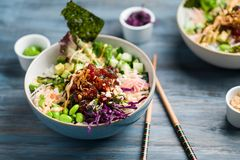 Ahi tuna poke bowl meal horizontal view. Poke is a traditional Hawaiian dish influenced by japanese and asian cuisine. Ahi poke is made of raw tuna chunks Royalty Free Stock Images