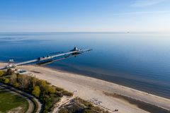 A drone flies over the sea bridge of Ahlbeck. Drone flies over the sea bridge of Ahlbeck stock photography