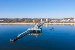 Drone flies over the sea bridge of Ahlbeck on Usedom. A drone flies over the sea bridge of Ahlbeck on Usedom royalty free stock photos
