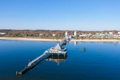 Drone flies over the sea bridge of Ahlbeck on Usedom. A drone flies over the sea bridge of Ahlbeck on Usedom royalty free stock images