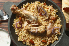 Ahmedi Biryani - An Indian dish containing meat, fish, or vegetables. Ahmedi Biryani - Ahmedi biryani is cooked in an earthen pot for many hours on very low Stock Photo