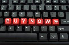 Ahora compre el botón rojo Imagen de archivo