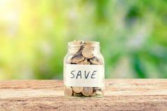 Ahorre el dinero en el vidrio fotos de archivo