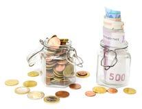 Ahorre el dinero, las monedas y los billetes de banco Fotos de archivo libres de regalías