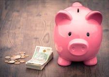 Ahorros/concepto de /money de la hucha del crecimiento Fotos de archivo