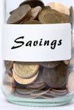 Ahorros del tarro de las monedas Imagenes de archivo