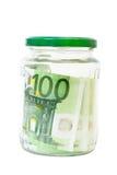 Ahorros euro de los billetes de banco en un tarro Foto de archivo libre de regalías