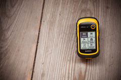 Ahrntal, Italy - October 11, 2014: GPS Garmin receiver is recordind positioning log over a wooden background Royalty Free Stock Images
