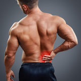Ahtletic muscle man back pain Stock Image