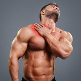 Ahtletic muscle man neck pain Stock Photo