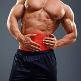 Ahtletic muscle man Pain in abdomen Royalty Free Stock Photos