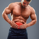 Ahtletic muscle man Stomach ache Royalty Free Stock Photo
