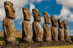 Ahu Akivi. Moais At Ahu Akivi on Rapa Nui With Cloudy Sky Background royalty free stock photography