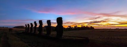 Ahu Akivi at sunset. Panorama of moais at Ahu Akivi at sunset, Easter island (Rapa Naui), Chile royalty free stock photos