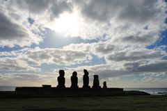 Ahu Tahai Sunset, Rapa Nui. Moai are monolithic human figures carved by the Rapa Nui people on Easter Island in eastern Polynesia between the years 1250 and 1500 royalty free stock photography