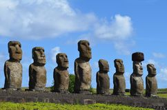 Moais in the ceremonial platform Ahu at Tongariki beach, Rapa Nui Easter island. Ahu Tongariki is the largest ahu on Easter Island. Its moai were toppled during Stock Photos