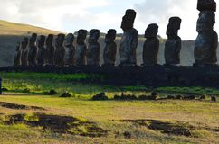 Moais in the ceremonial platform Ahu at Tongariki beach, Rapa Nui Easter island. Ahu Tongariki is the largest ahu on Easter Island. Its moai were toppled during Royalty Free Stock Photo