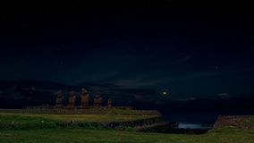 Ahu Vai Uri moonlit under a starry sky, Easter Island, Chile Stock Image