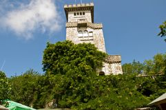 Ahun tower green trees foliage. Ahun castle building stone gray tower, trees foliage, greens, sky cloud Royalty Free Stock Photography