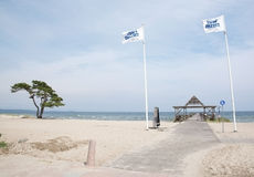 Ahus beach with flags and pier Stock Photos