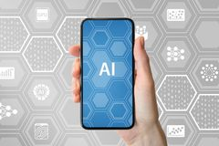 AI / artificial intelligence concept. Hand holding modern frameless smartphone in front of neutral background with icons Stock Images