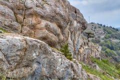 Ai-petri Crimea. Rocky Mountain Peak with forest on hillside Ai-petri Crimea Landscape Summer day with blue sky on background royalty free stock photo