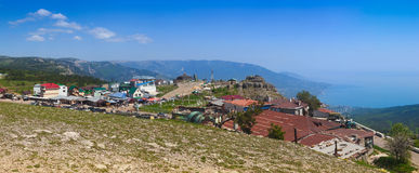 Ai-Petri. People admire excellent panorama of Yalta and coastline of Black Sea from view point on top of mt Ai-Petri. Mt Ai-Petri (St Peter, 1234m) is one of stock photo