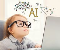 AI text with toddler girl. Using her laptop Stock Photography