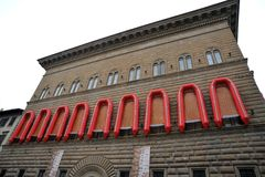 Ai Weiwei art exhibition of lifeboats on the Palazzo Strozzi facade Stock Photo